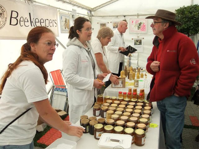 A beekeeping stand at a farmers market