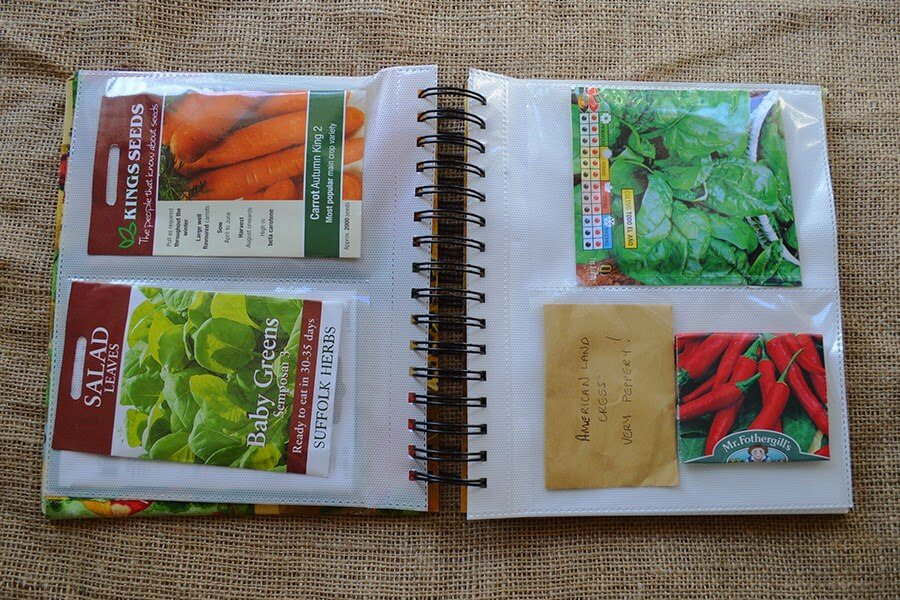 Use an old photo album to create a clever seed packet organizer! Cover the album in fabric for a finishing touch #crafts