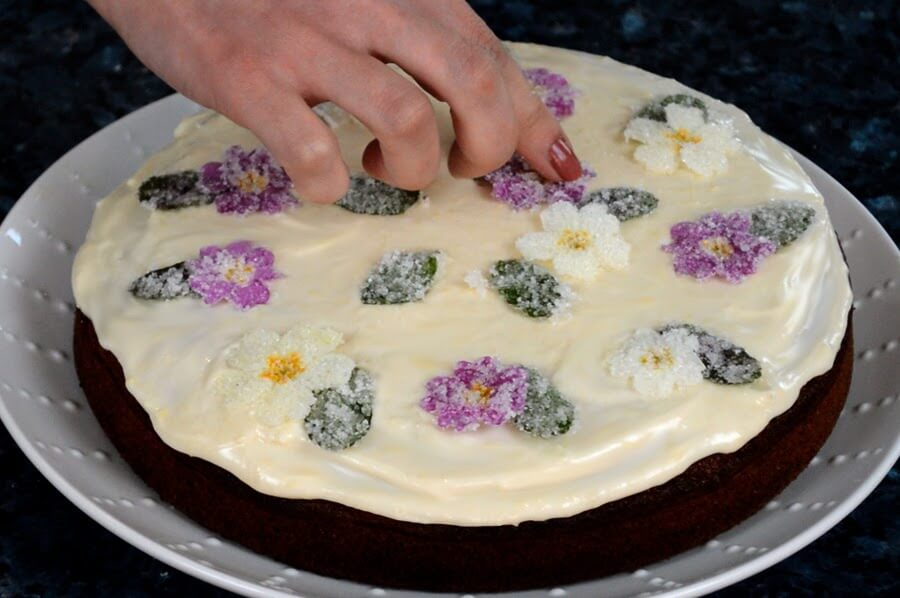 Preserve edible flowers in sugar for sweet decorations for desserts and cakes