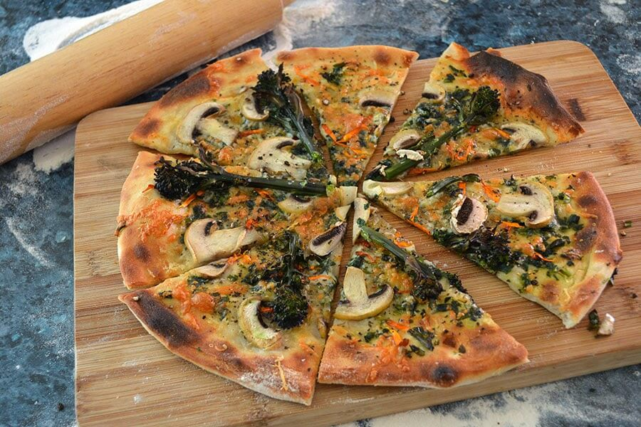 Wild Garlic Pizza Recipe ~ a white pizza topped with fresh veggies, cheese, olive oil, wild garlic, and Calendula flower petals #pizza