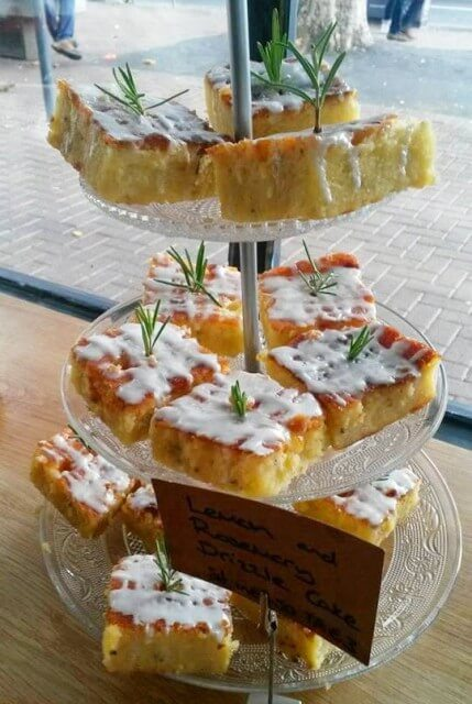 A light and fluffy lemon drizzle cake infused with fresh rosemary. An unusual and delicious flavor combination perfect for summery cakes and cupcakes #cake #drizzlecake #lemoncake