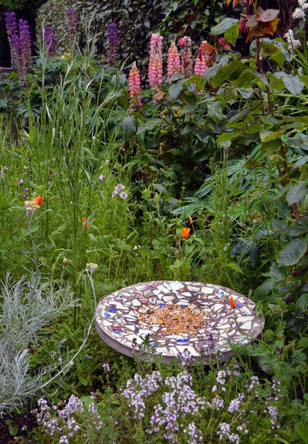 Instructions on how to make a DIY Mosaic Bird Feeding Table - an artistic project that's 'For the Birds