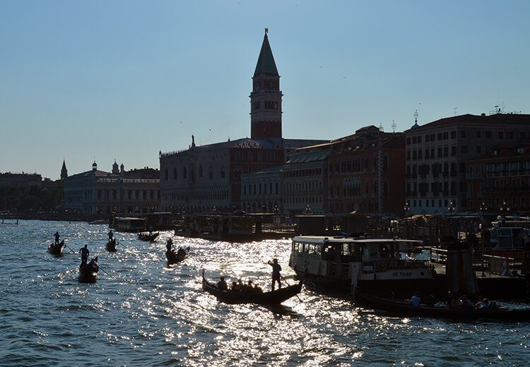 Gondolas at San Marco. Photo diary of a solo trip to Venice, Italy, one of the most romantic cities in the world.