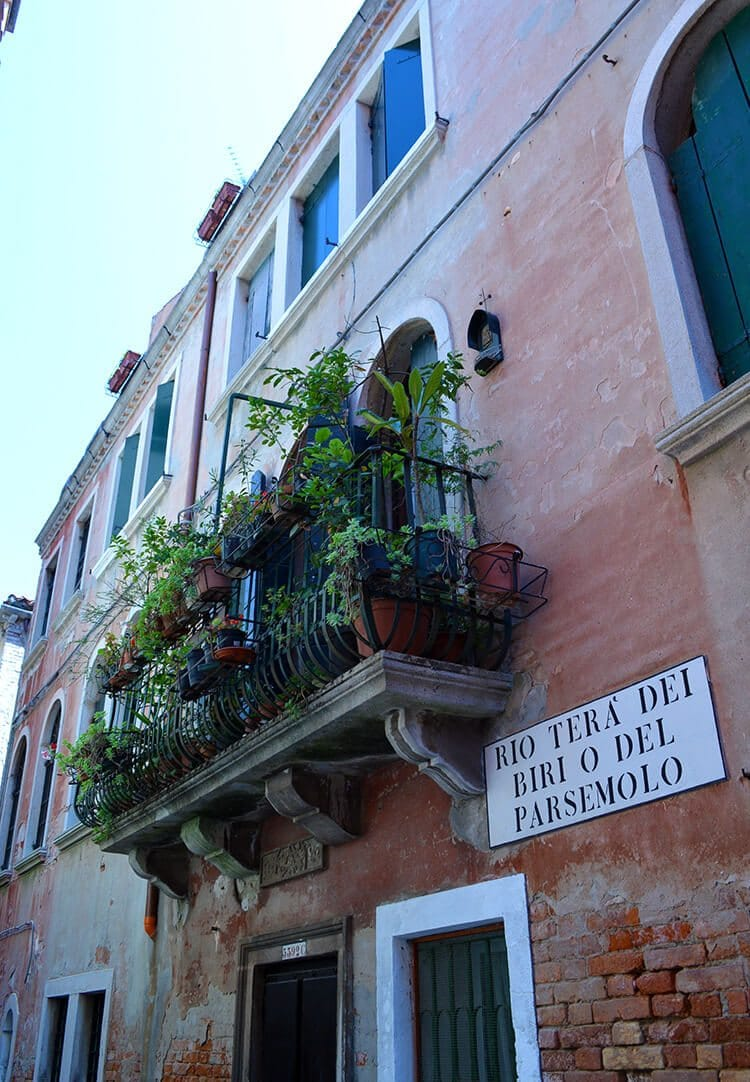 Lush balcony. Photo diary of a solo trip to Venice, Italy, one of the most romantic cities in the world.