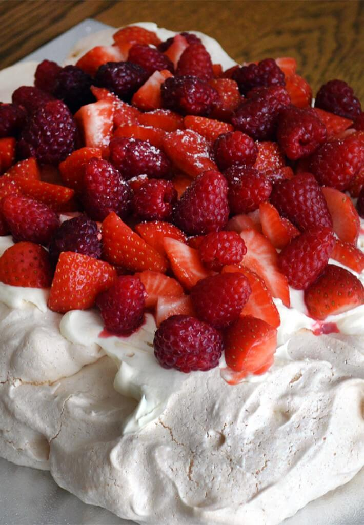 Easy recipe for light-as-air Pavlova with fresh cream, Strawberries and Raspberries - you only need a few ingredients and it's very simple to make!
