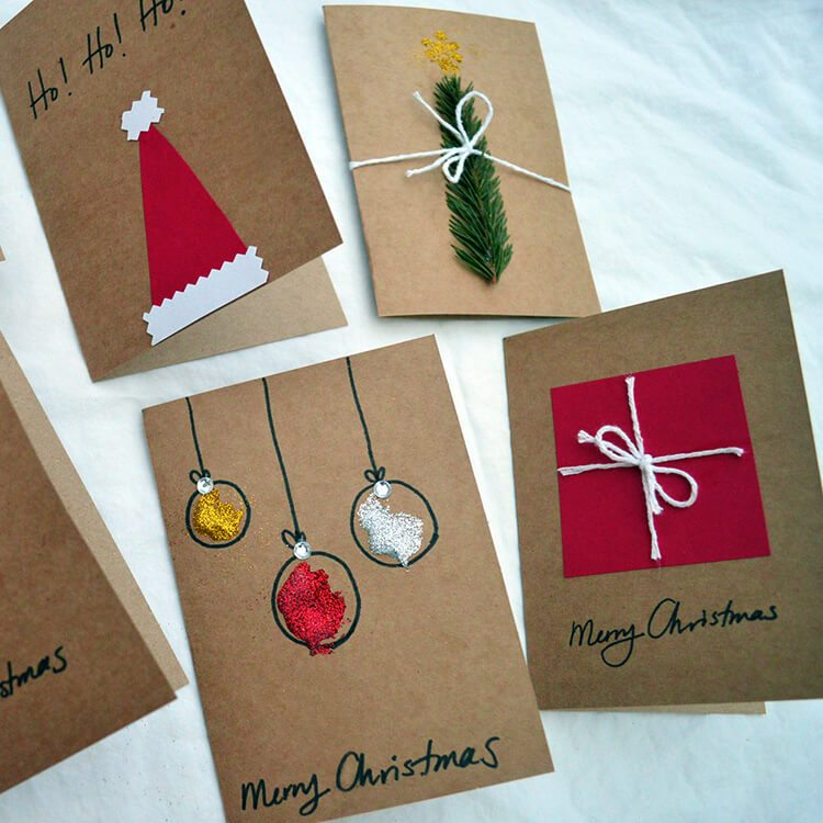 Handmade Christmas cards made using Kraft paper, string, gilitter, and greenery.