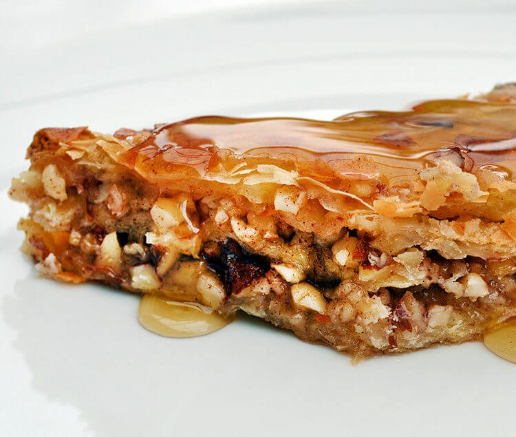 Honey and Almond Baklava recipe - filo pastry layered with chopped nuts and soaked in a spiced honey syrup