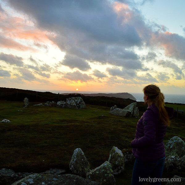 Winter Solstice on the Isle of Man: watching the sun set on the darkest day of the year from the Meayll Hill Stone Circle.