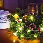 How to use a colander, foraged greenery, & extra decorations to make a Christmas greenery centerpiece. A thrifty & clever project for a handmade Christmas #lovelygreens #greenery #centerpiece #diychristmas