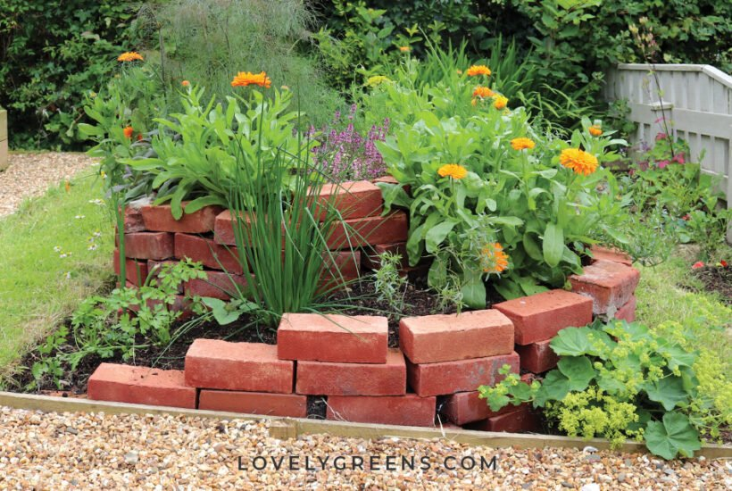 Grow more herbs in less space in a DIY Herb Spiral. This innovative outdoor herb garden allows you to grow more herbs in less space using an attractive spiral design. Instructional video included #herbgarden #permaculture #diygarden