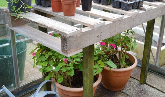 Instructions for making a DIY Pallet Wood Potting Bench from Lovely Greens