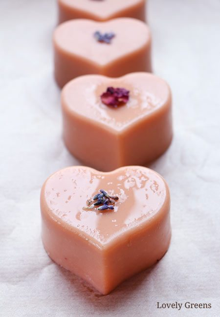 Make natural soap with French pink clay and beautifully scented essential oils that help balance the heart chakra. A lovely choice as a Valentine's Day soap recipe#lovelygreens #soaprecipe #heartchakra #valentinesday