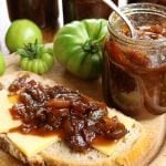 Easy green tomato chutney recipe with green tomatoes, red onions, malt vinegar, and spices. A delicious condiment that pairs well with cheese & cured meat #greentomatoes #preserving #canning #preservetheharvest
