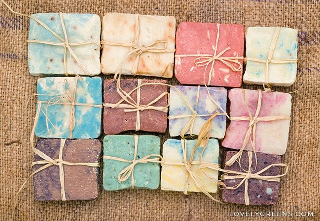 twelve bars of different colored soap tied with natural coloured raffia ribbon