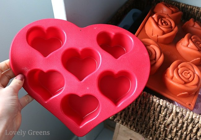 Make natural soap with French pink clay and beautifully scented essential oils that help balance the heart chakra. A lovely choice as a Valentine's Day soap recipe #lovelygreens #soaprecipe #heartchakra #valentinesday