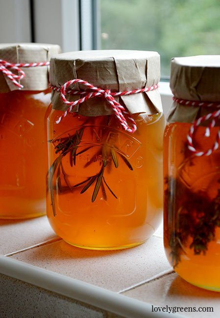 How to subtly flavor honey with sweet herbs and spices. Delicious on yogurt, appetizers, or in desserts and makes great handmade gifts #honeyrecipe #preserving #herbs