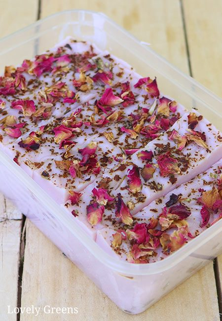 Learn to make natural rose geranium soap with essential oils, mineral color, and dried flower petals. Part of the Simple Soap Recipe series that includes three other soap recipes #lovelygreens #soapmaking #rosegeranium #soaprecipe