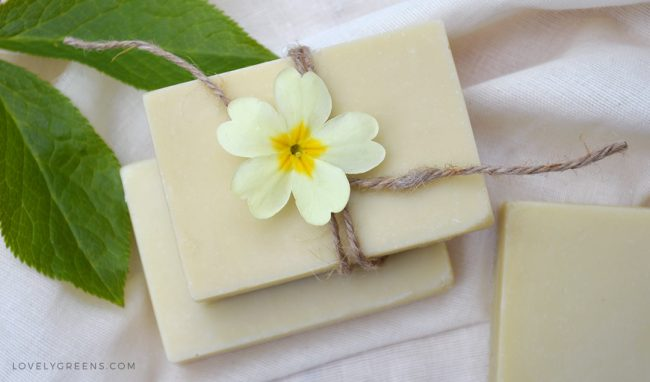 Light coloured natural bars of soap on a fabric back drop