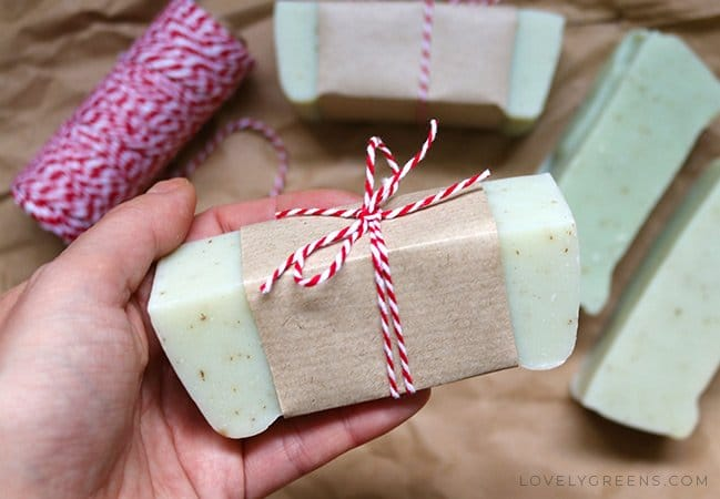 Green soap wrapped with brown paper and a red and white striped string