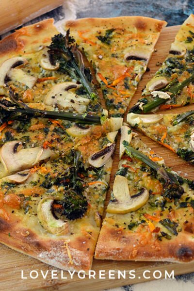 Serve up a spring feast with wild garlic pizza with fresh mushrooms, purple sprouting broccoli, and calendula flower petals #wildfood #foraging #springrecipe